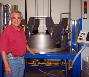 Ron Marquez with all new computerized hoop welding machine.